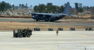 A U.S. military cargo aircraft arriving for rescue