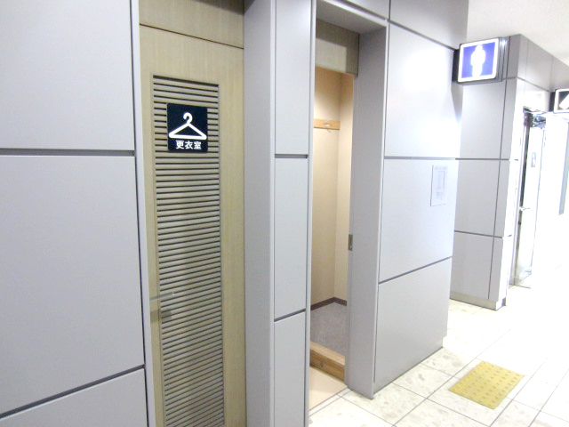 It is located next to the toilet for men.